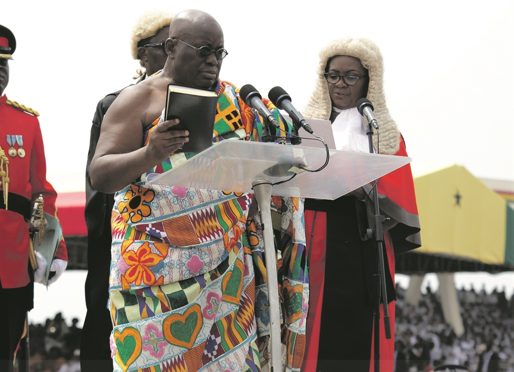 PREZ RELEASE Nana Akufo-Addo is sworn in as Ghana's new president at Independence Square in Accra, Ghana, on January 7. Inserts: President Jacob Zuma (top) and US President Donald Trump. Picture: Getty Images