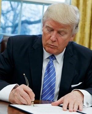 President Donald Trump signs an executive order . (Evan Vucci, AP)