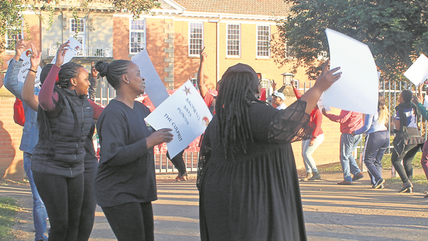 Members of trade unions seen picketing outside the school on Wednesday.
