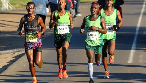 Comrades Marathon champion Bongmusa Mthembu (left) has returned from training in Lesotho to attend the funeral of his friend and fellow runner Sphiwe Ndlela (right).