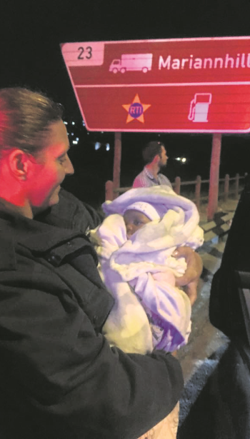 Baby Siwaphiwe Mbambo was found unharmed during the early hours of Sunday morning after a vehicle was intercepted at the Mariannhill Toll Plaza. She is being held by a member of the Metro police.
