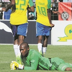 Orlando Pirates goalkeeper is dejected as Mamelodi Sundowns celebrate yet another point scored during the Absa Premiership match played against the Bucs at Loftus Versfeld. (Sydney Mahlangu, BackpagePix)