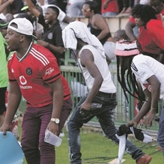 NO-GO AREA: Orlando Pirates supporters could not contain their anger at Loftus and invaded the pitch. (Sydney Seshibedi, Gallo Images)
