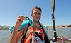 Andy Birkett shows his winners medal at the finish of the Dusi Canoe Marathon at Blue Lagoon in Durban on Saturday.