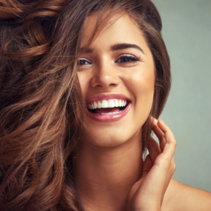 Woman with flawless skin smiling