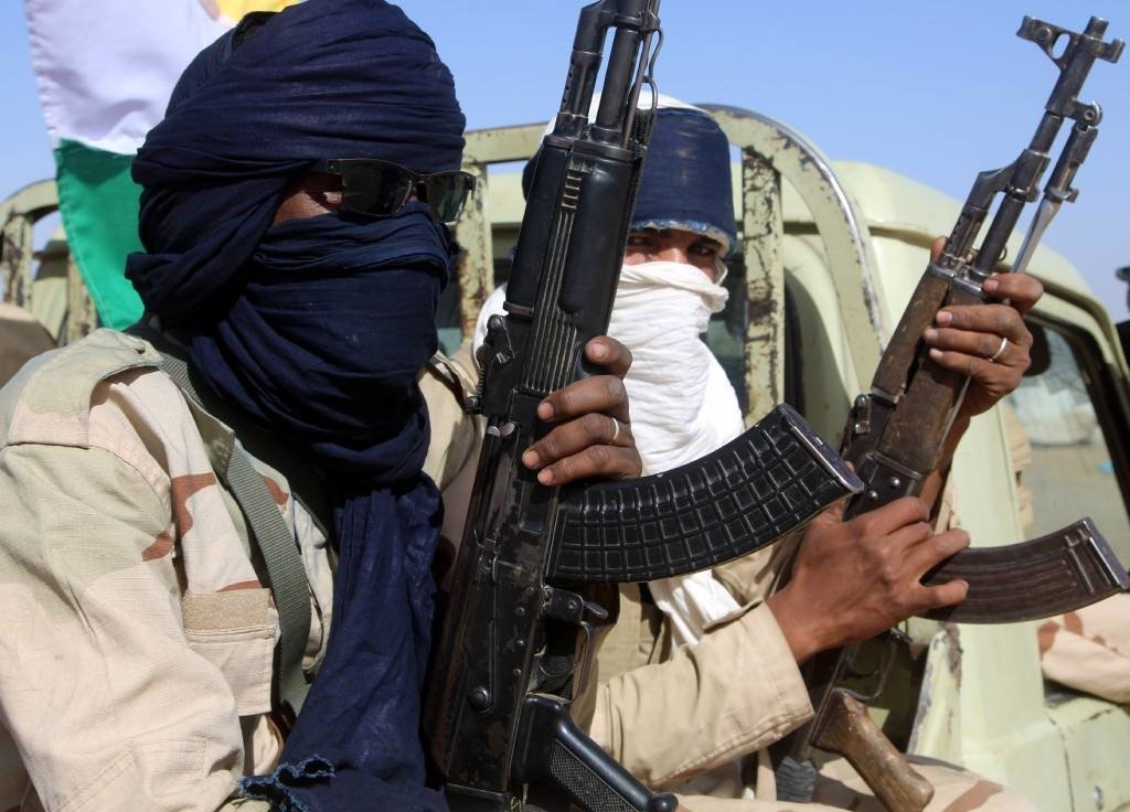 Coalition of the People of Azawad (CPA) fighters are seen holding weapons while sitting on a Land Cruise, while patrolling the area near the Mali-Mauritania border to protect local populations from insecurity.