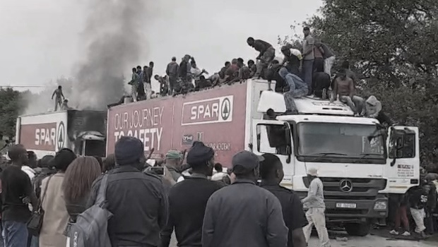 Mooi River residents loot a truck during a protest that blocked the N3 toll plaza and the R103 on Tuesday.