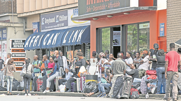 Stranded bus travellers waiting for delayed buses at the long-distance bus station in Pietermaritzburg on Wednesday.