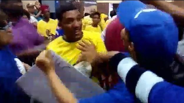 The video shows a woman in full ANC regalia screaming and shouting in front of DA supporters as a confrontation breaks out.