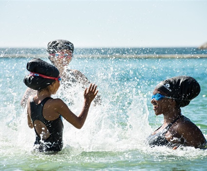 A swimming cap is all that stands between South Africa and the sea