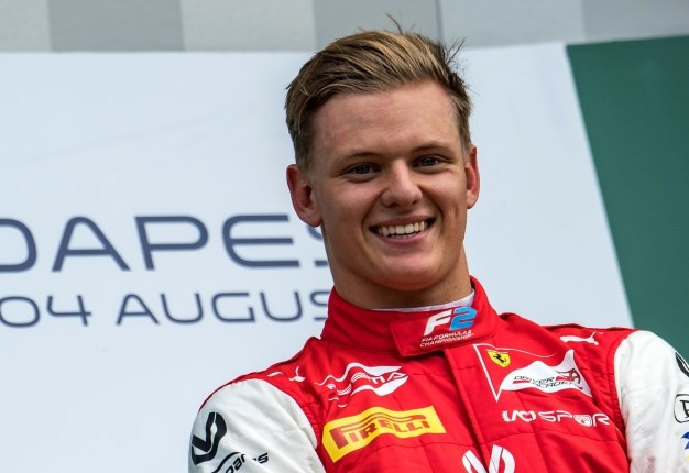 Mick Schumacher celebrates after winning the F2 race at the Hungarian GP. <i> Image: AFP / Andrej Isakovic </i>