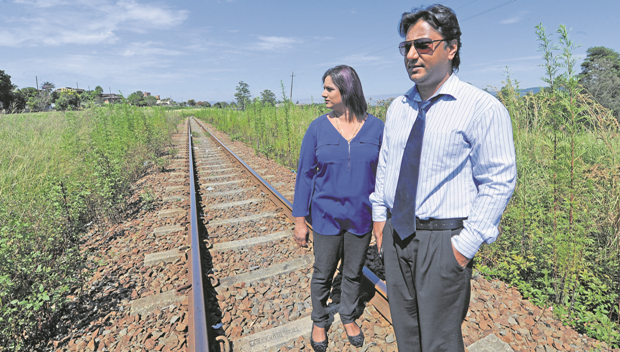 Mount View Residents Against Crime members Nishwan Suresh and Sue Trytsman inspect the railway line near Woodpecker Road in Northdale on Thursday..