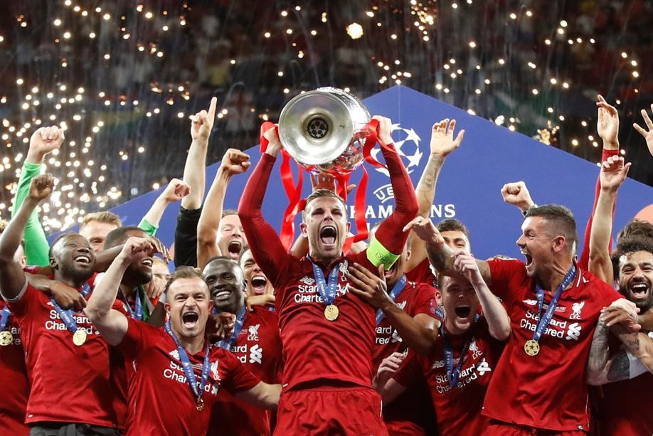 Jordan Henderson celebrates with the trophy and his Liverpool teammates after winning the Champions League final against Tottenham Hotspur. Picture: Carl Recine/Reuters