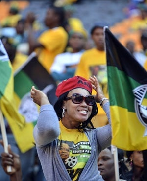 An ANC supporter dances at FNB Stadium. (AFP)