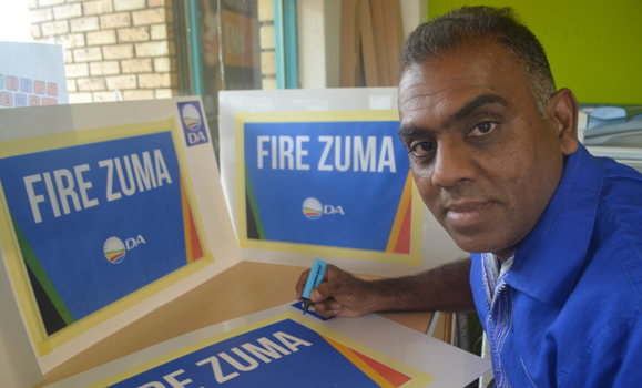 Democratic Alliance provincial deputy leader Mergan Chetty finishes off sign boards ahead of the party's picket in Pietermaritzburg.