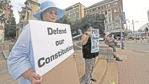 Local activist Fiona Bulman holds a placard during the anti-Zuma silent protest held opposite the City Hall. She has been doing the protest daily from 11?am to 11.30?am.
