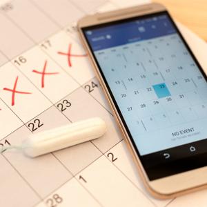 Tampon, calendar and smartphone