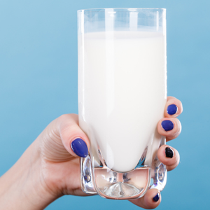 Woman holding glass of milk linked to acne