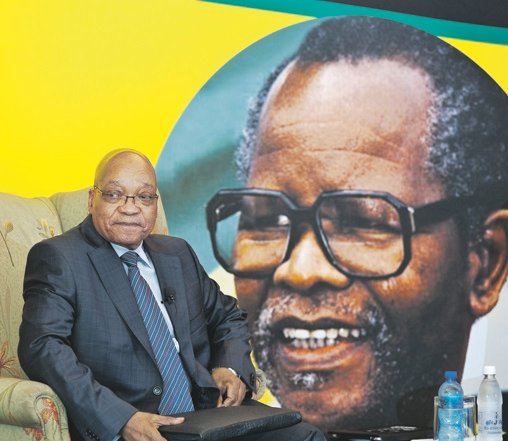 IN THE SHADOW OF GREATNESS President Jacob Zuma sitting in front of a portrait of the ANC's former president, Oliver 'OR' Tambo, who would have turned 100 this year. Picture: Louise Gubb / Corbis via Getty Images