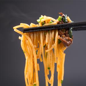 chopsticks holding pasta