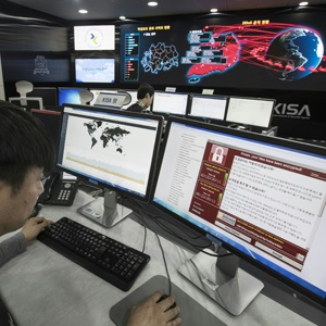 A staff member monitors the spread of ransomware c