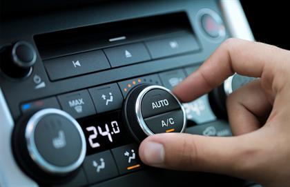 Person adjusting car air con