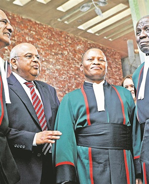 From left: Justice Zak Yacoob, Minister of Finance Pravin Gordhan, Chief Justice Mogoeng Mogoeng and Deputy Chief Justice Dikgang Moseneke at the Constitutional Court in Braamfontein in this file picture Photo: Lerato Maduna
