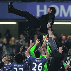 Chelsea's manager Antonio Conte is lifted into the air by his players after winning the league championship. Picture: Matt Dunham / ap