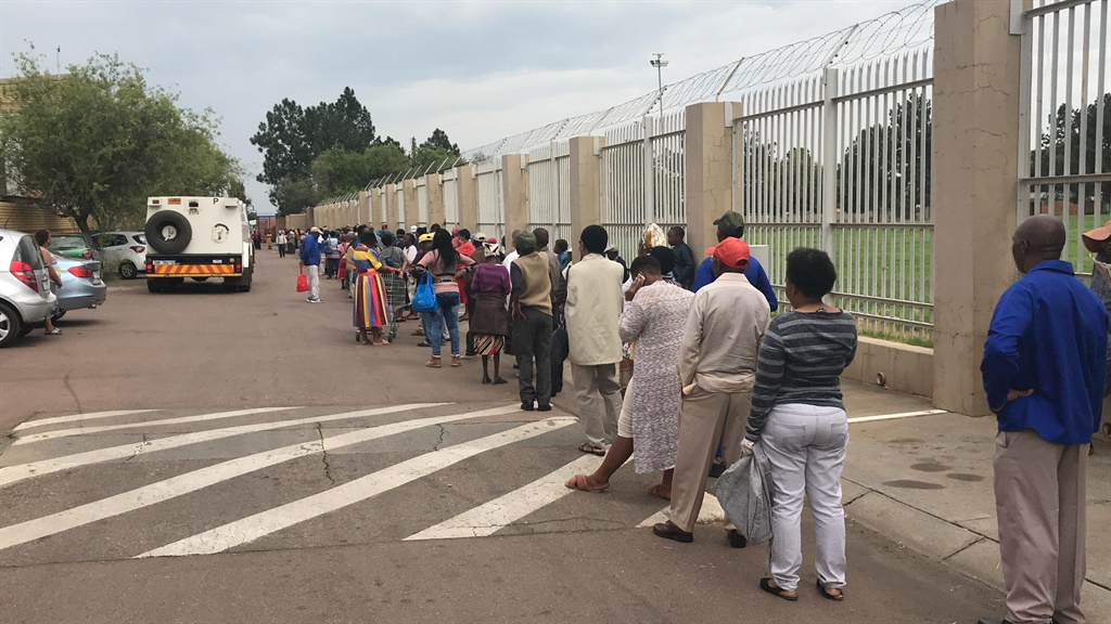 A queue at Denlyn shopping centre in Mamelodi where people are lining up to collect their social grants