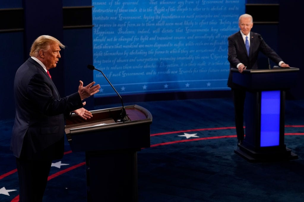 President Donald Trump answers a question as Democratic presidential candidate former Vice President Joe Biden listens during the second and final presidential debate.