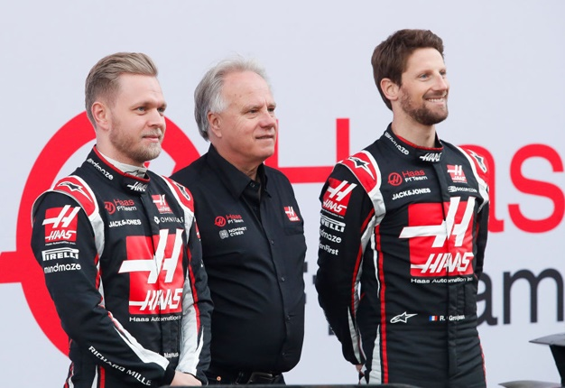 Kevin Magnussen (left) and Romain Grosjean (right) with team owner, Gene Haas (Getty Images)