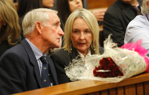 June Steenkamp, mother of Reeva Steenkamp, is seen with flowers (foreground) during judgment in  the murder trial of  paralympian Oscar Pistorius in Pretoria, Thursday, 11 September 2014. Picture: Kim Ludbrook/EPA/Pool