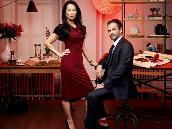 Foto van Lucy Liu en Jonny Lee Miller - Sherlock en Watson