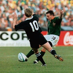 SA fly half Joel Stransky kicks the winning drop goal amid a challenge by New Zealand's Andrew Mehrtens, who himself scored two drop goals in the 1995 World Cup final between the two nations. PHOTO: Gallo Images