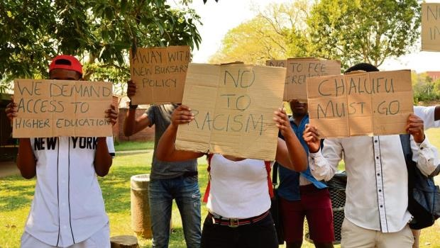 UKZN students hold up placards during their protest yesterday. Negotiations with management entered their third week.