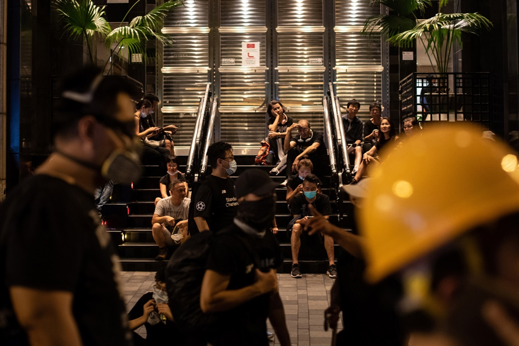 Protesters sit on the steps of a building in Tsim Sha Tsui in Hong Kong in the latest opposition to a planned extradition law that has evolved into a wider movement for democratic reforms.  (Philip FONG / AFP)