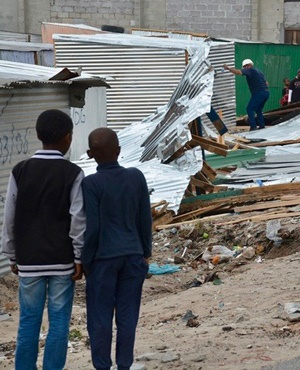 A number of shacks at Xhwithinja, on the corner of Emms Drive and Lansdowne Road, Philippi, Cape Town, were demolished. (Buziwe Nocuze, GroundUp)