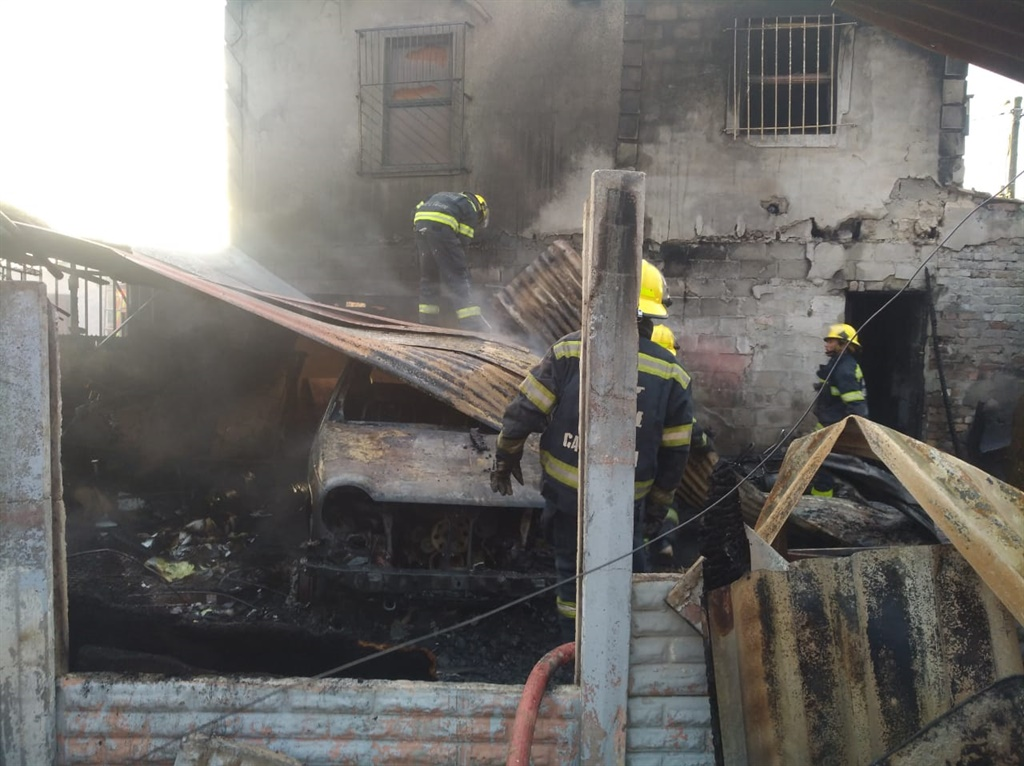 Firefighters extinguish the blaze in Samora Machel. (supplied)