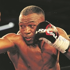ATTACK: Thabiso Mchunu catches his opponent with a right body shot on the way to winning the ABU cruiserweight crown at Emperors Palace. (Leon Sadiki)