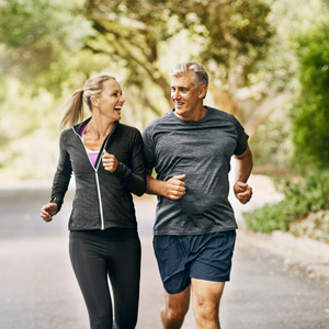 Older couple running outdoors
