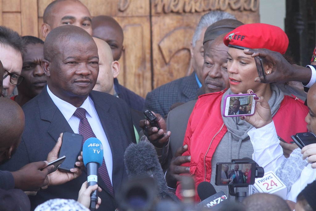 VINDICATED UDM leader Bantu Holomisa, flanked by Cope's Mosioua Lekota and EFF's Leigh-Ann Mathys, says they feel vindicated by Chief Justice Mogoeng Mongoeng's ruling. Picture: Ndileka Lujabe