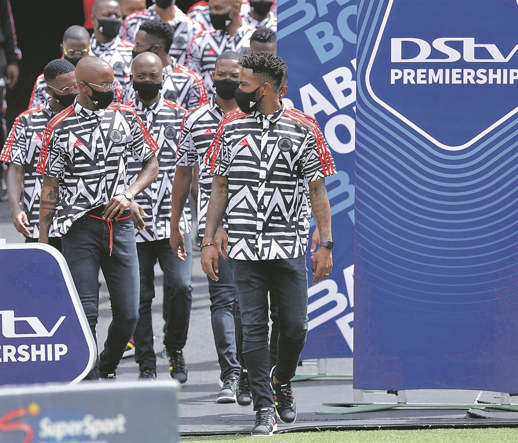 Orlando Pirates captain Thulani Hlatshwayo leads his team-mates out for a pitch inspection ahead of the recent Soweto derby, rocking Tshepo Jeans. Picture: Supplied