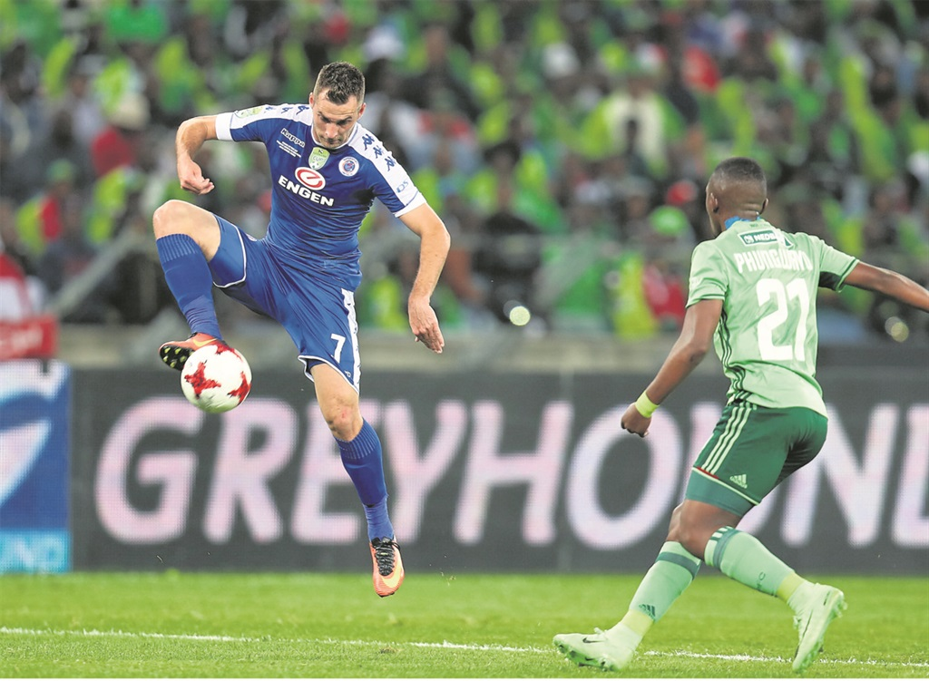 Quantum leap: Bradley Grobler of SuperSport United is challenged by Patrick Phungwayo of Orlando Pirates during their Nedbank Cup final in Durban last night Picture: Muzi Ntombela / BackpagePix