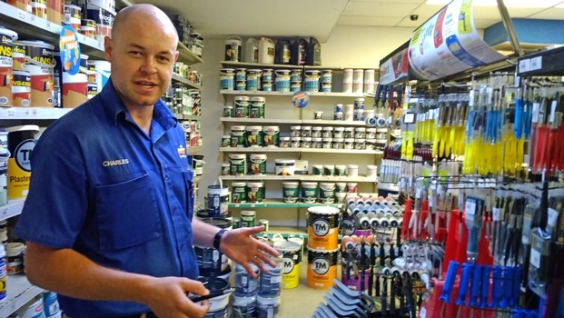 Managing director of a Mica Hardware branch, Charles Kirton, shows the area where two shoplifters put stolen items in a bag.