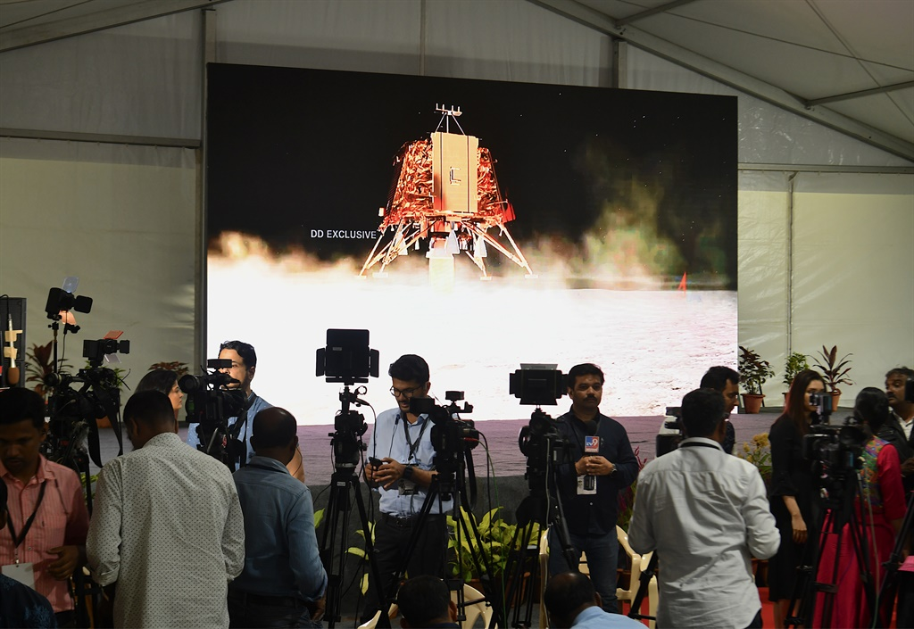 Members of the India media cover the developments at ISRO Telemetry Tracking and Command Network (ISTRAC) facility in Bangalore. (Manjunath Kiran, AFP)
