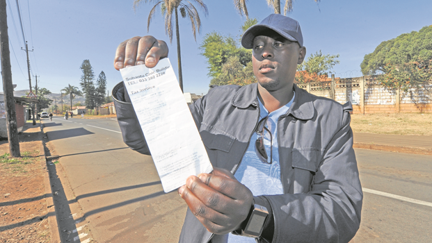 Sobantu resident Xolani Dladla with his prepaid electricity receipt showing that Sobantu residents had an 18% increase implemented on their electricity tariff recently.