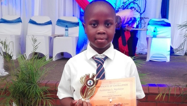 Ayabonga Ngobese pictured holding a certificate of academic excellence in Grade 4 that he received from his school last year. 'He was a respectful and smart boy. He was all ready for school and excited about going back today,' said his mother, Nozipho.