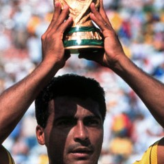 The outstanding player of the tournament, Brazilian Romario, lifts the trophy.