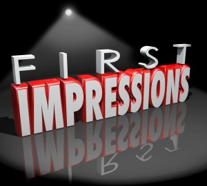 First Impressions words in 3d letters under a spotlight as an introduction to new people, a meeting or debut