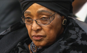 Winnie Mandela, the ex-wife of former South African President Nelson Mandela, attends his funeral in his ancestral village of Qunu in the Eastern Cape province, 900 km (559 miles) south of Johannesburg, in this still image taken from December 15, 2013 video courtesy of the South Africa Broadcasting Corporation (SABC). REUTERS/SABC via Reuters TV (SOUTH AFRICA - Tags: OBITUARY POLITICS HEADSHOT)  ATTENTION EDITORS - FOR EDITORIAL USE ONLY. NOT FOR SALE FOR MARKETING OR ADVERTISING CAMPAIGNS. NO SALES. NO ARCHIVES. SOUTH AFRICA OUT. NO COMMERCIAL OR EDITORIAL SALES IN SOUTH AFRICA. THIS PICTURE WAS PROCESSED BY REUTERS TO ENHANCE QUALITY